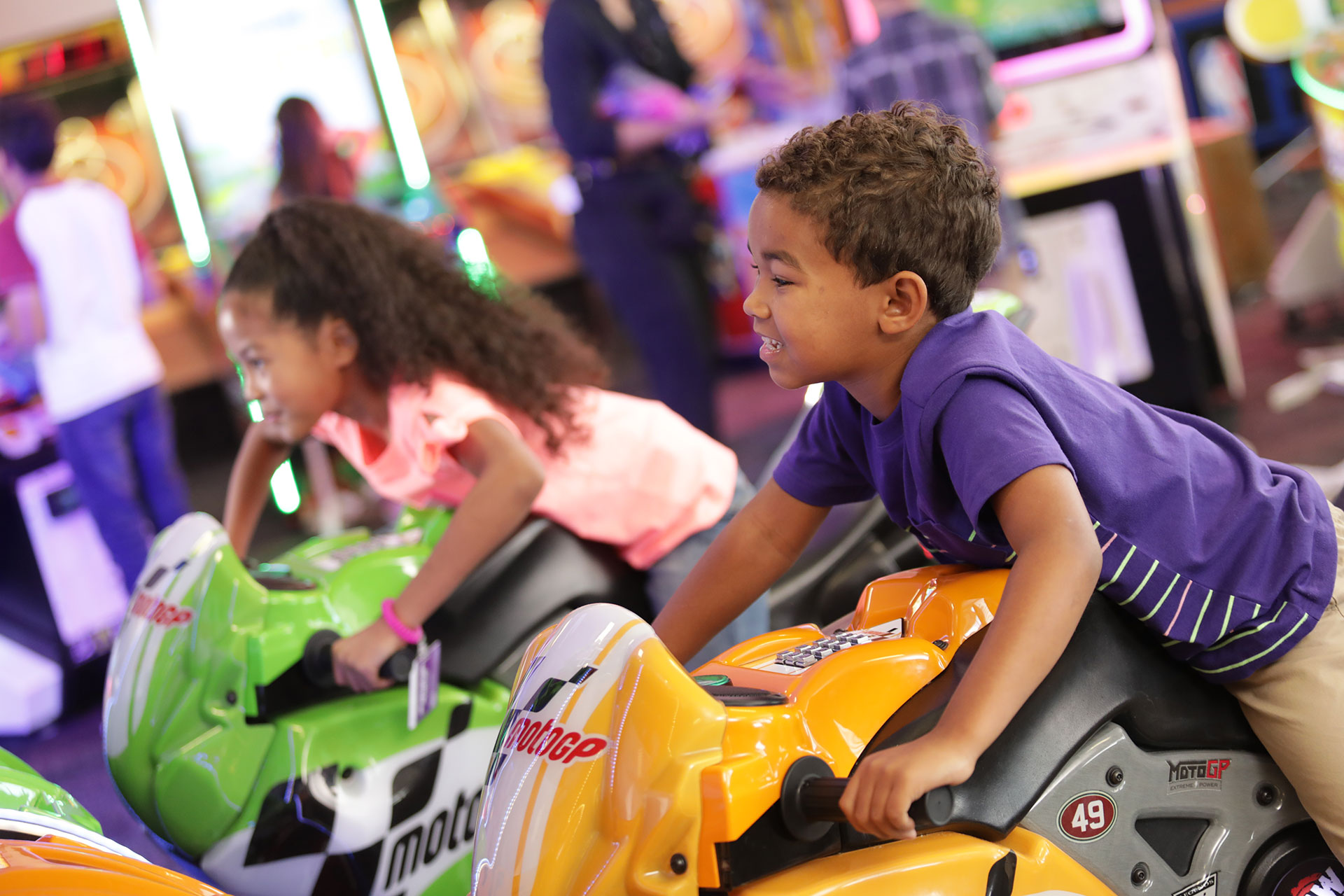 Kids on motorcycle arcade game